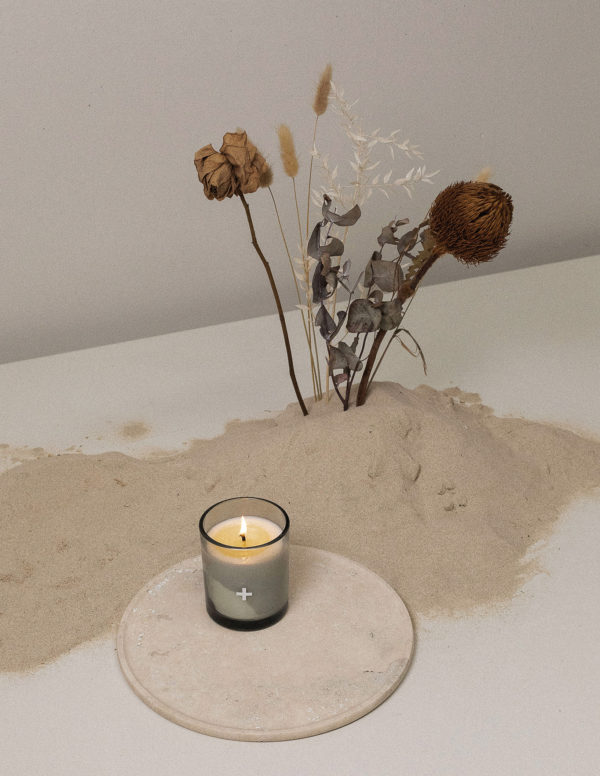 mimosa rocks candle by addition studio on a large marble plate or travertine plate addition studio