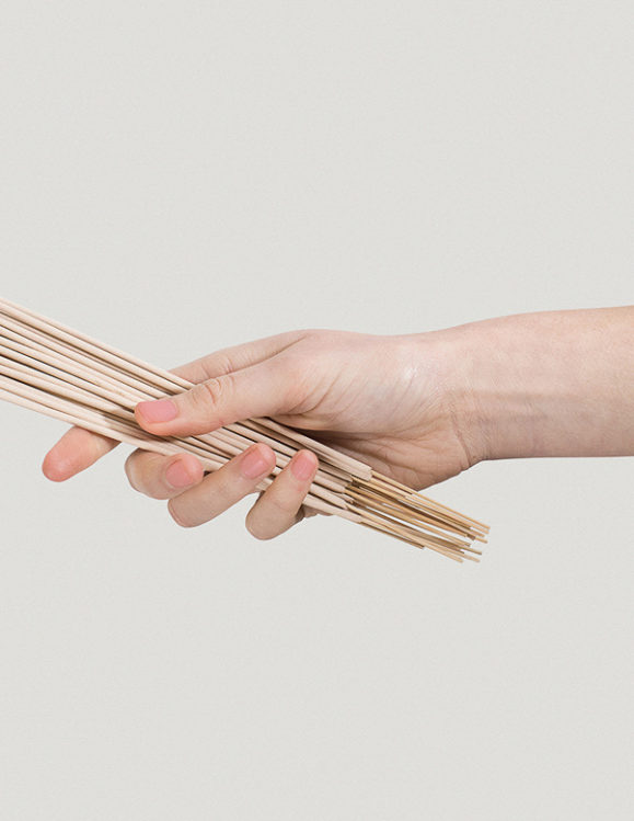hand holding addition studio australian native incense - An all in one designer incense set which includes brass holder, ash catcher and 15 Incense Sticks. Simply flip the lid & insert the solid piece into it. Light your incense and rest it vertically within the hole. Commence Relaxation. - juniper berry & frankincense