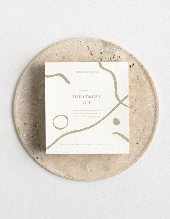 australian native treatment set by addition studio placed on a travertine stone serving plate