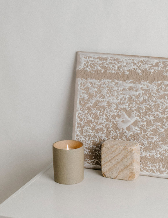 galax sunflower candle by addition studio in stone vessel