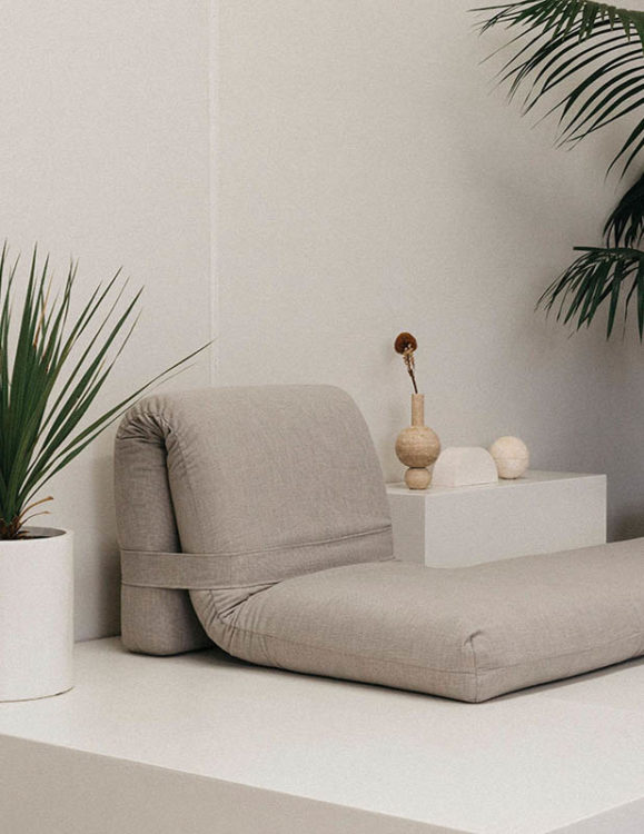 caterpillar couch by addition studio - floor couch - travertine vase - travertine incense burner