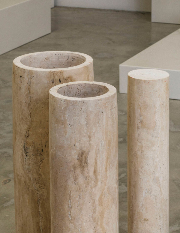 introvert dining table - travertine dining table legs - cylindrical travertine table legs by addition studio