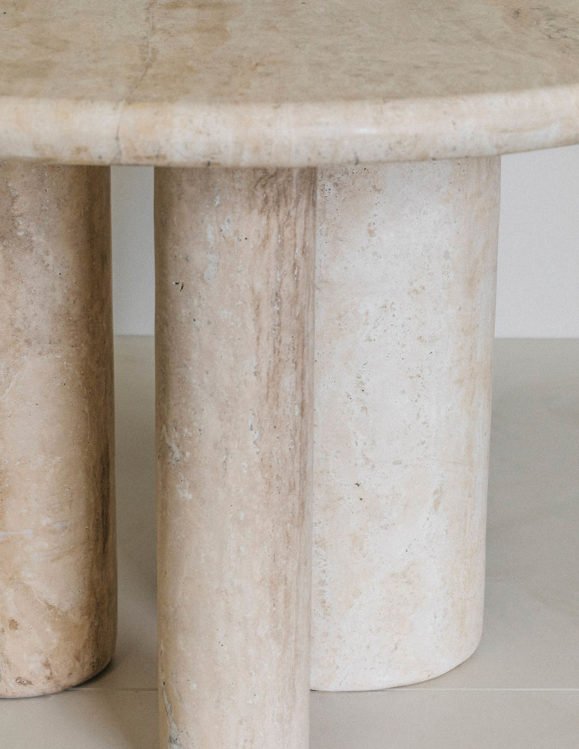 introvert dining table - travertine dining table legs - cylindrical travertine table legs and travertine table top by addition studio