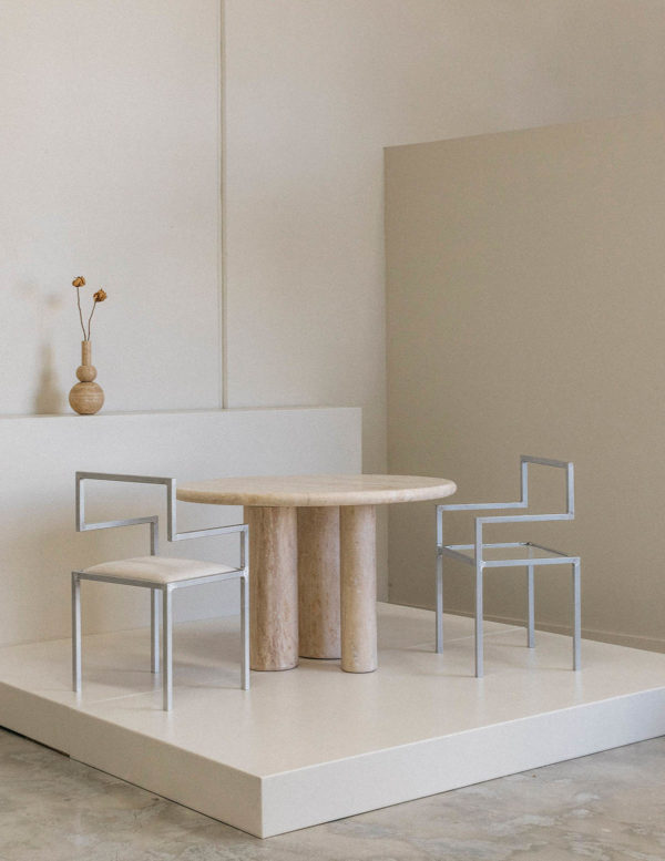 travertine introvert dining table - travertine dining table - stone dining table - stone table - solid travertine table - invisible chair - famous designer chair and table set