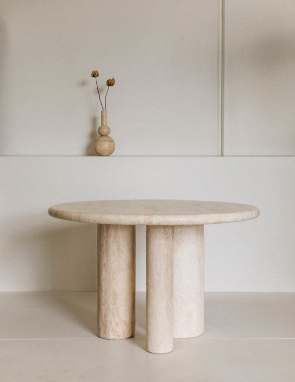 Introvert travertine dining Table - designer dining table in travertine - addition studio dining table - travertine vase - famous designer travertine dining table