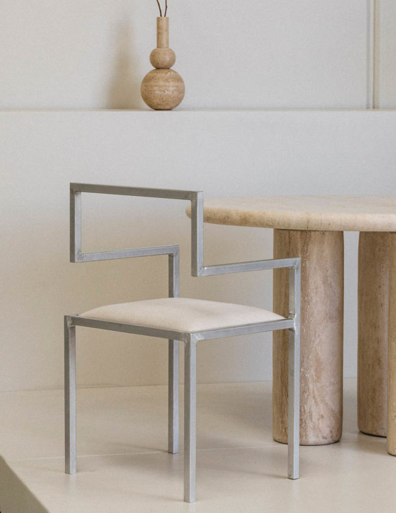 invisible chair by addition studio - designer chairs - designer furniture - homewares and furniture australia - famous designer chairs - designer dining chairs - travertine dining table - travertine vase - travertine furniture