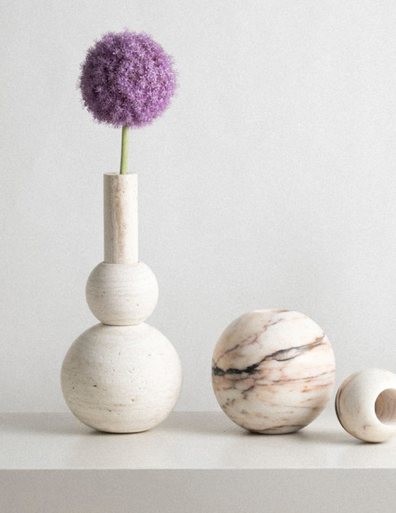 travertine vase with purple flower and picasso marble sphere incense burner