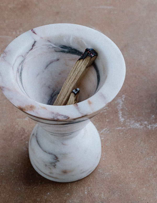marble incense burner with dark and red veins of marble colouring