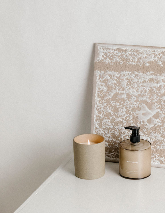 natural and organic moisturiser and stone candle holder with cande
